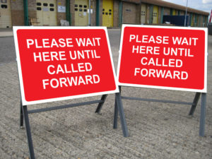 Impact_COVID 19   Stanchion Temp Sign_Please Wait Here_Superimposed