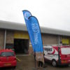 Branded Feather Flags With Water Filled Base External Outdoor Events Exhibitions Marketing Advertising - Impact Signs